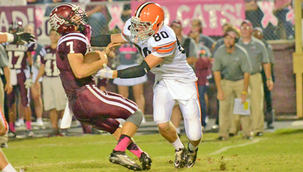Ironton Fighting Tigers' defensive end Joe Bowling (80) brings down Ashland quarterback Hunter Prince during last week's game. Ironton hosts Portsmouth at 7:30 p.m. Friday. (Tony Shotsky of Southern Ohio Sports Photos)