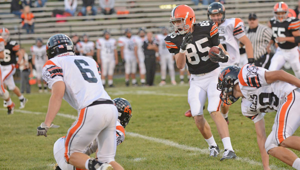 Ironton Fighting Tigers' tight end Lucas Campbell runs with the ball after making a catch against Amanda-Clearceek last week. Campbell's catch went for 18 yards in a 14-7 win. (Tony Shotsky of Southern Ohio Sports Photos)