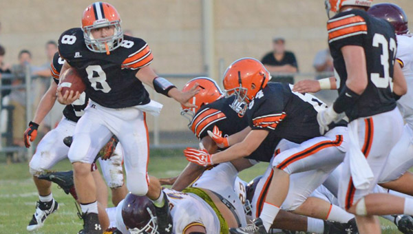 Ironton Fighting Tigers' quarterback Tristan Cox (8) fights his way through the Russell defense during Friday's game. Cox ran for 139 yards, threw for 61 and scored three touchdowns in a 35-14 win. (Tony Shotsky of Southern Ohio Sports Photos)
