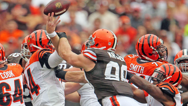 Cleveland Browns linebacker Paul Kruger, right, hits Cincinnati Bengals quarterback Andy Dalton, who attempts to throw a pass at FirstEnergy Stadium in Cleveland on Sunday. The Browns won, 17-6. (MCT DIrect Photo)