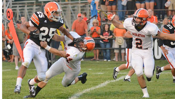 Ironton sophomore running back Jake Long (25) fights off Wheelersburg's Conner Stone (44) during Friday's game at Tanks Memorial Stadium. Long had a 97-yard kickoff return for a touchdown but the Fighting Tigers had four turnovers in a 49-12 loss. (TONY SHOTSKY of Southern Ohio Sports Photos)