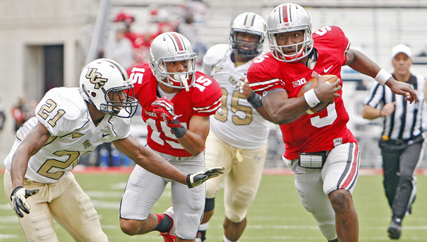 "Ohio State Buckeyes' quarterback Braxton Miller (5) is listed as ""day to day"" with a sprained knee injury he suffered last Saturday in a win over San Diego State. (MCT Direct Photo)"