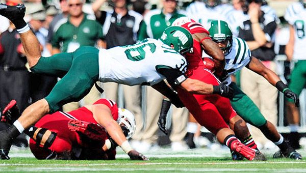 Ohio Bobcats' linebacker Ben Russell (36) dives to make the stop of a Louisville running back during Sunday's game. Russell made the tackle but the Bobcats lost their season opener to the No. 9-ranked Cardinals 49-7. (Photo Courtesy of Ohio University Sports Information)