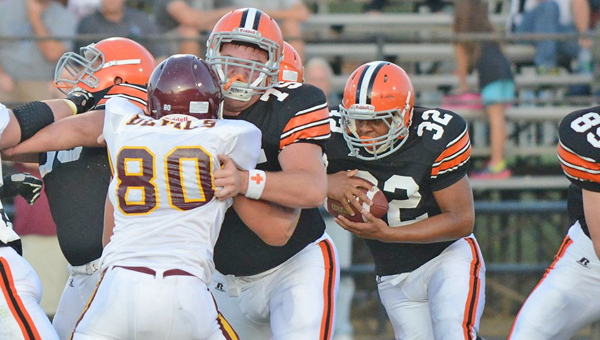 Ironton Fighting Tigers' fullback Desmond Young (32) follows the blocking of tackle Isaac Sherman (77)  to gain yardage in last week's win over Russell. Ironton hosts Amanda-Clearcreek on Friday. (Tony Shotsky of Southern Ohio Sports Photos)
