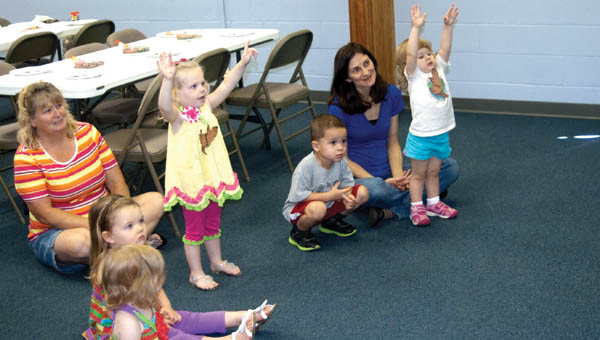 Children exercise at the direction of Jan Gullett during Toddler Time.