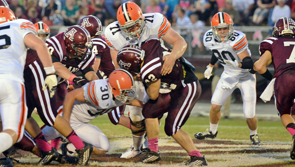 Ironton defensive tackle Adam Webb (71) wraps up Ashland fullback Josh Vaughn while Trevor Easterling (30) helps Webb on the stop. Ironton had four turnovers in a 42-20 loss at Ashland on Friday. (Tony Shotsky of Southern Ohio Sports Photos)