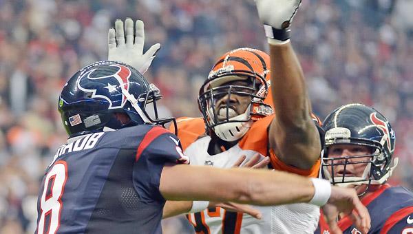 Cincinnati Bengals' defensive lineman Geno Atkins (97) pressures Houston quarterback Matt Schaub during a game last season. (MCT Direct Photos)
