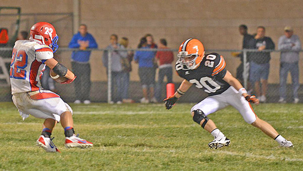 Ironton Fighting Tigers' senior defensive back Blake Taylor (20) closes in to make the stop on Portsmouth running back Johnnie Charles during last week's game. Ironton hosts Johnson Central Friday. (Tony Shotsky of Southern Ohio Sports Photos)