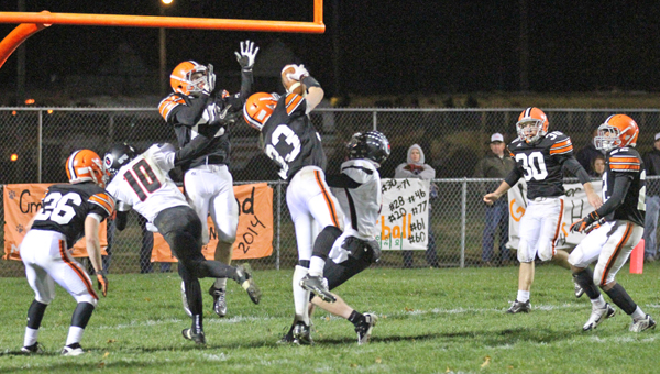 Ironton Fighting Tigers' linebacker Jeremy Bodmer (33) intercepts a pass near the goal line on the final play of the game in a 20-14 win over the Oak Hill Oaks last week. Ironton plays at Raceland Friday and needs a win to make the playoffs. (Courtesy of Tim Gearhart of Tim's News & Novelties in Ironton)