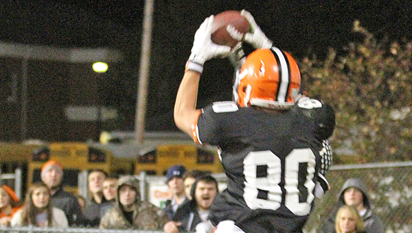 Ironton Fighting Tigers' receiver Joe Bowling (80) goes up in the air over an Oak Hill defensive back to snag the winning touchdown pass from Tristan Cox with 25 seconds to play. The score gave Ironton a 20-14 win over Oak Hill on Friday. (Courtesy of Tim Gearhart of Tim's News & Novelties in Ironton)