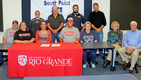 South Point Lady Pointers' senior softball standout Katelyn Brown signed a letter of intent to play next fall at the University of Rio Grande. Attending the signing ceremony were: seated from left to right, parents Robert and Angie Black, Katelyn, grandparents Mike and Kathy Payne and Debbie and Jim Brown; standing from left to right, Rio Grande head coach Kristen Bradshaw, K.C. Diamond team coach Tony Ellis, South Point head coach Tanner Heaberlin and K.C. Diamond team coach Barry Powell. (Kent Sanborn of Southern Ohio Sports Photos)