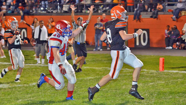 Ironton Fighting Tigers' quarterback Tristan Cox (8) runs for a touchdown during an earlier game this season against Portsmouth. Ironton plays at Columbus Bishop Hartley on Friday. (Tony Shotsky of Southern Ohio Sports Photos)