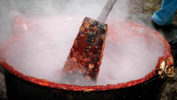 The apple butter made at the Lawrence Furnace Church must be churned for hours a day. The Church has been making the preservative for 70 years.