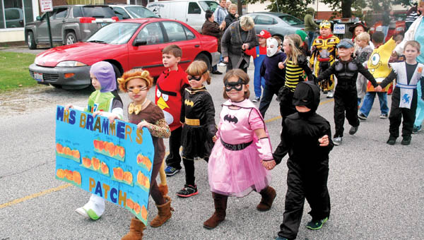 """Students from Christy Brammer's class walk in South Point Elementary Halloween Parade this past Friday. Un""""boo""""lievable readers were recognized during South Point Elementary School's Halloween Parade this past Friday. Students and teachers dressed in costumes and those who have earned the most accelerated reader (AR) points rode on floats."""