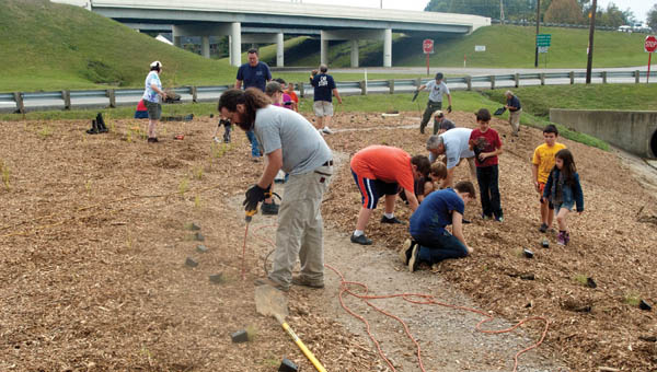Volunteers work to plant a garden of native plants at St. Mary's Medical Center-Ironton Campus in Ironton.