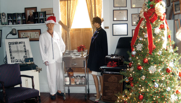 The doctor's room in the Lawrence County Museum, along with the other rooms in the former Col. Gray home, are being decorated for the holiday season.