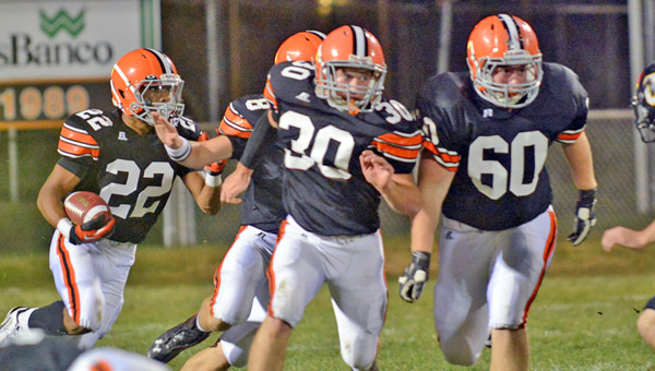 Ironton Fighting Tigers' running back D'Angelo Palladino (22) follows the blocking of Trevor Easterling (30), Justin Robinson (60) and Tristan Cox (8) on a sweep as he gains some of his 138 yards in last week's game against Johnson Central. Ironton plays at Columbus St. Charles Friday. (Tony Shotsky of Southern Ohio Sports Photos)