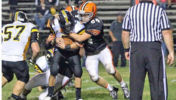 Ironton Fighting Tigers' junior linebacker Harley Paholsky (64) makes the stop on Johnson Central running back Josh Gound during Friday's game at Tanks Memorial Stadium. Ironton fell to the unbeaten Eagles, 56-14. (Courtesy Tim Gearhart of Tim's News & Novelties in Ironton)