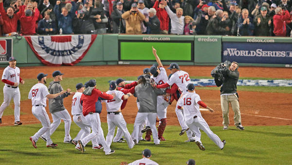 The Boston Red Sox celebrate after the final out in Game 6 of the World Series against the St. Louis Cardinals at Fenway Park in Boston on Wednesday. The Red Sox won, 6-1, to clinch the championship. (MCT Direct Photos)