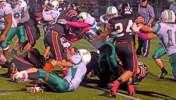 Fairland Dragons' defensive player Derick Willis (26) stops Coal Grove Hornets' running back Isaiah Gunther (8) on a running play during Friday's Ohio Valley Conference game. The Dragons won 44-27 to take over sole possession of first place. (Kent Sanborn of Southern Ohio Sports Photos)