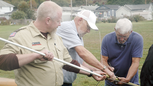 A 2-meter 440 UHF-VHF antenna is assembled behind Ironton's Central Christian Church in preparation for this Saturday's 56th Jamboree on the Air. The event pairs Boy Scouts with members of the Southern Ohio Amateur Radio Association (SOARA) to communicate with scouts around the world and encourage youth to be ham radio operators. Pictured, from left, Troop 106 Assistant Scout Master Tim Nicely and SOARA members James Rowe and Dave Spears.