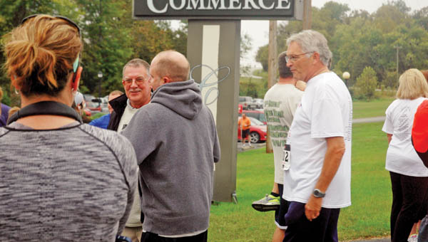 Brandon Trent and his father, Robert, wait for the inaugural Brian Trent Memorial 5K Race to begin at The Point.