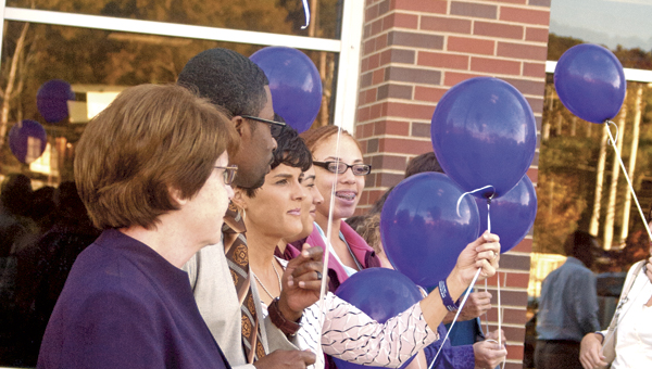 The audience at this year's Domestic Violence Awareness event participate in Monday night's balloon release.