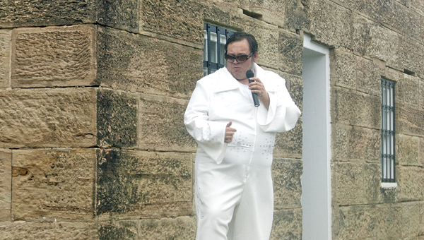 "South Point High School English teacher Ben Music channeled his inner ""King"" at the second annual Historic Jail Preservation Corporation's ""Jailhouse Rock""-themed fundraiser in Burlington on Saturday."
