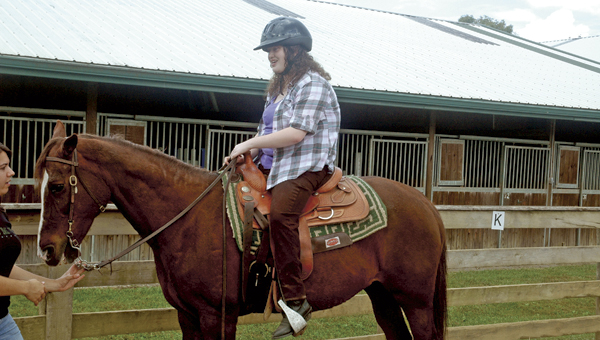 Ohio University Southern equine studies student Jamie Nelson, of Salt Rock, W.Va., rides Ivy at the Ohio Horse Park. Nelson is also a volunteer in the park's therapeutic horsemanship program.