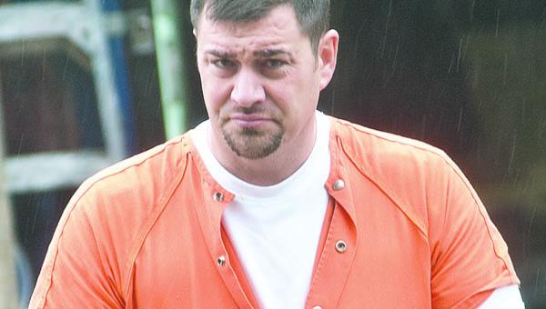 Patrick Richard walks to his arraignment.