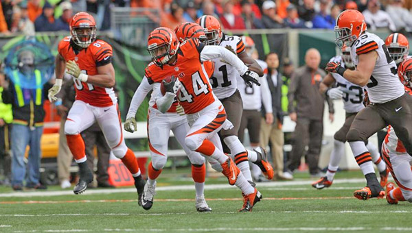 Cincinnati Bengals' safety Tony Dye (44) returns a blocked punt by teammate Jayson DiManche for a 24-yard touchdown in the second quarter. The Bengals beat the Cleveland Browns 41-20 Sunday in Cincinnati. (Photo Courtesy of The Cincinnati Bengals)
