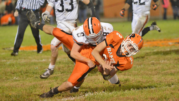 Ironton Fighting Tigers' defensive back Tristan Cox (8) makes a hard hit on Raceland wide receiver Rodney Vance during Friday's game. Raceland managed to beat Ironton 17-0. (Tony Shotsky of Southern Ohio Sports Photos)