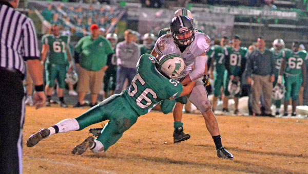 Fairland Dragons' linebacker Clayton Edmonds (56) brings down at River Valley runner during a game last week. The Dragons' defense will be a key when Fairland visits Wheelersburg Saturday in the Division V playoffs. (Kent Sanborn of Southern Ohio Sports Photos)