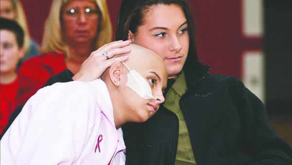 Laken Short offers a shoulder to lean on to her friend Ashley Dennison during the National Honor Society Fashion Show benefit event at Rock Hill Saturday. The event was held on honor of Ashley whom is battling cancer.