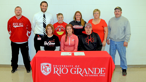 Rock Hill Redwomen senior softball standout Brooke Hanshaw signed a letter-of-intent to play for the University of Rio Grande. Attending the signing ceremony were: seated from left to right, mother Amy Hanshaw, Brooke, and father Ryan Hanshaw; standing from left to right, Rock Hill assistant coach Greg Damron, Rock Hill head coach Sammy Gue, sister Makenzie Hanshaw, Rio Grande head coach Kristen Bradshaw, former Rock Hill head coach Mary Harper and former Rock Hill assistant coach Mark Harper. (Kent Sanborn of Southern Ohio Sports Photos)