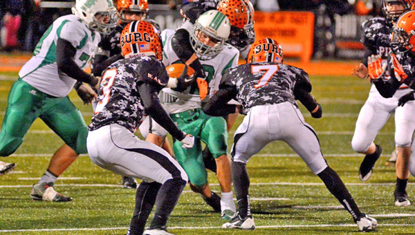 Fairland Dragons' running back Evan Maddox (32) runs inside against the Wheelersburg defense. The Pirates' Austin May (7) and Tyler Claxon (3) attempt to make the stop. Fairland lost the playoff game 40-21. (Kent Sanborn of Southern Ohio Sports Photos)