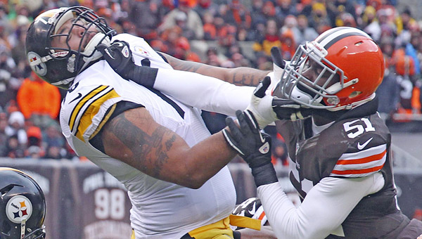 Cleveland Browns' Barkevious Mingo, right, fights through the block of Pittsburg Steelers offensive tackle Mike Adams during the first quarter at FirstEnergy Stadium on Sunday, in Cleveland. The Steelers won, 27-11. (MCT Direct Photos)