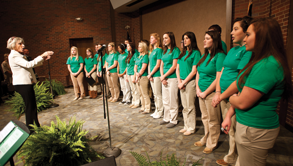 Kathy Price, far left, directed the Ironton High School Varsity Singers.