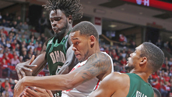 Maurice Ndour (5) and Nick Kellogg (15) of the Ohio Bobcats compete with Amir Williams (23) of the Ohio State Buckeyes for a rebound by at Value City Arena in Columbus on Tuesday. Ohio State held on to win 79-69. (MCT Direct Photo)