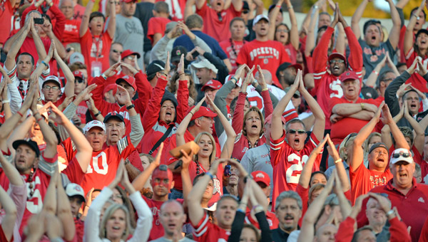 Ohio State Buckeyes' football fans cheer for their team during the games, but they express frustration afterwards with the BCS playoff system that may leave their team out of the championship game. (MCT Direct Photos)