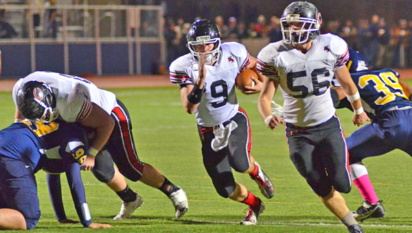 Coal Grove Hornets' quarterback Jesse Rigsby (9) follows teammate David Abrams (56) as he leads him upfield during Friday's game at South Point. Rigsby ran for 113 yards in the Hornets 56-14 win. (Courtesy Robert S. Stevens of The Gold Studio in Ironton)