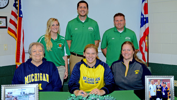 Fairland Lady Dragons' 6-foot-4 senior center Terra Stapleton signed a national letter-of-intent Wednesday to play basketball at the University of Michigan. Attending the signing ceremony were: seated from left to right, grandmother Gloria Stapleton, Terra and mother Cathy Stapleton; standing from left to right, Fairland assistant coaches Katie Fuller and Adam Alt and head coach Jon Buchanan. (Kent Sanborn of Southern Ohio Sports Photos)