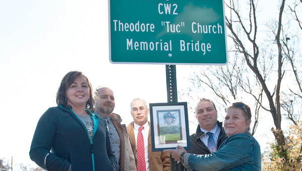 Theodore Church's widow Mindi Church, left, and other Betty Church, right are seen with all three Lawrence County Commissioners during a bridge dedication in Church's name Friday. Church died in 2007 while serving in Iraq.