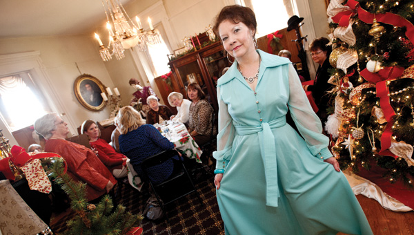 Floye Cooke models a light blue hostess dress during the Lawrence County Museum annual Christmas tea Saturday.