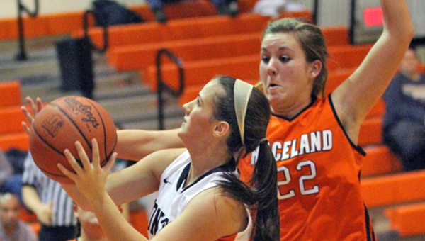 Ironton Lady Tigers' Jordan Hannan (left) drives past Raceland's Michelle Vanderhoof (22) for a layup. Ironton beat Raceland 50-43 Wednesday. (Photo Courtesy Tim Gearhart of Tim's News & Novelties of Ironton)