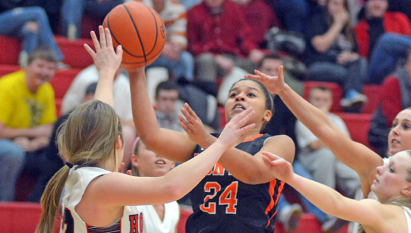 Ironton Lady Fighting Tigers' Alyssa Lewis (24) gets off a shot whiile surrounded by Coal Grove defenders during Monday's game. Ironton won 58-43. (Kent Sanborn of Southern Ohio Sports Photos)