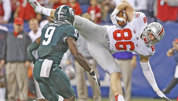 Ohio State tight end Jeff Heuerman (86) hits the ground after making a second-quarter reception in front of Michigan State's Isaiah Lewis (9) in the Big Ten Championship game at Lucas Oil Stadium in Indianapolis on Saturday. Michigan State upset Ohio State 34-24. (MCT Direct Photo)
