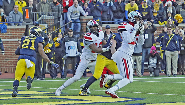 Ohio State Buckeyes defensive back Tyvis Powell (23) intercepts a two-point conversion against the Michigan Wolverines during the 4th quarter at Michigan Stadium in Ann Arbor, Mich., on Saturday. Ohio State won, 42-41. (MCT Direct Photo))
