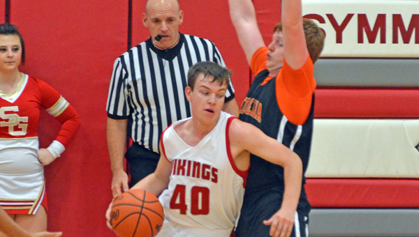 Symmes Valley's Jacob Klaiber (40) drives for two of his 17 pionts in the Vikings 75-61 win over South Gallia Friday. an orange out in support of Ashley Dennison, our student who is undergoing chemo treatments for kidney cancer. Both teams wore orange socks as well as many fans of both teams in support of Dennison. (Courtesy of Robert S. Stevens of The Gold Studio in Ironton)