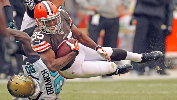 Cleveland running back Fozzy Whittaker, right, is upended by Jacksonville defensive end Andre Branch after a short gain at FirstEnergy Stadium on Sunday in Cleveland. The Jaguars defeated the Browns, 32-28. (MCT Direct Photo)